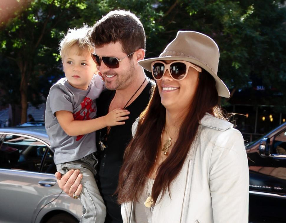 Former husband and wife: Robin Thicke and April Love Geary with their son Julian