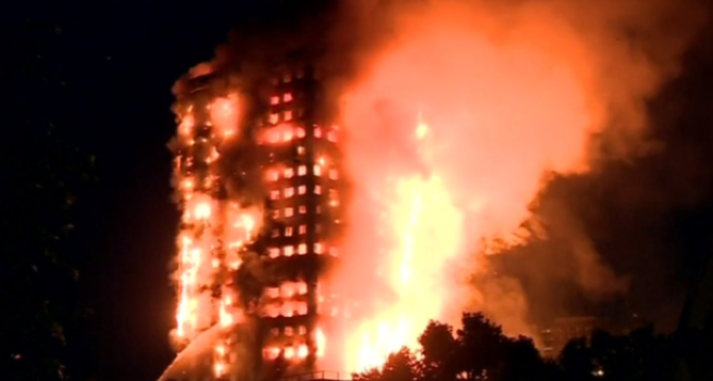 Fire engulfs London tower block, at least six dead, 69 injured