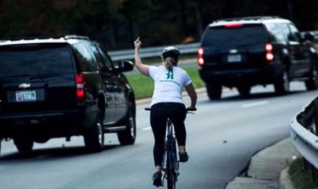 Cyclist who showed Trump 'middle finger' is showered with money